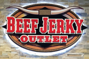 beef jerky outlet sign with bull horns in red brown white and black