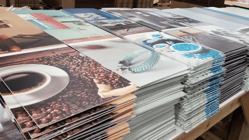 posters laying in piles on pallets