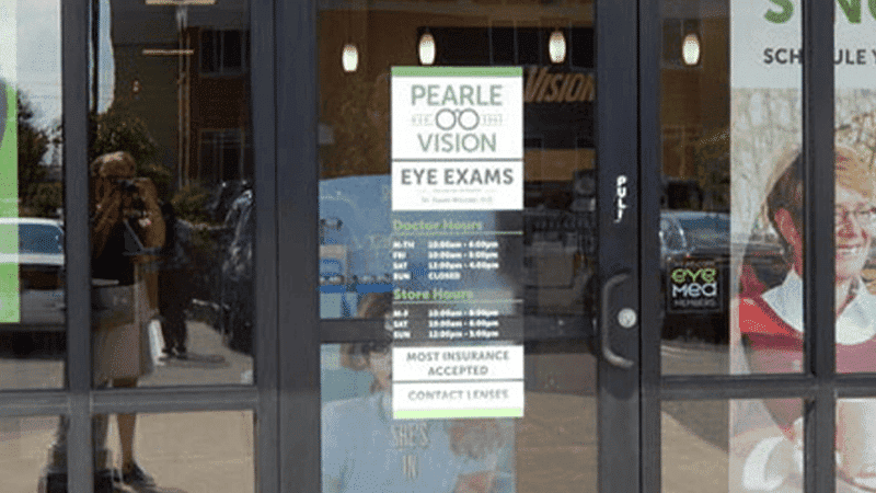 sign on store door for glasses