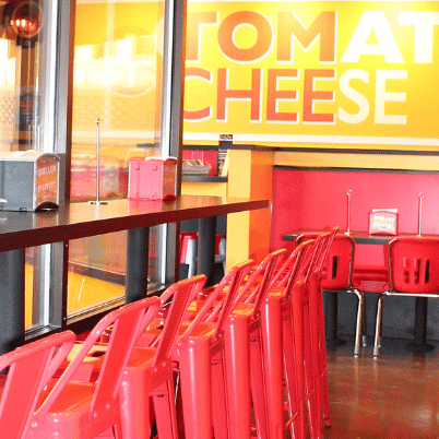 tom and chee retail signage and chairs