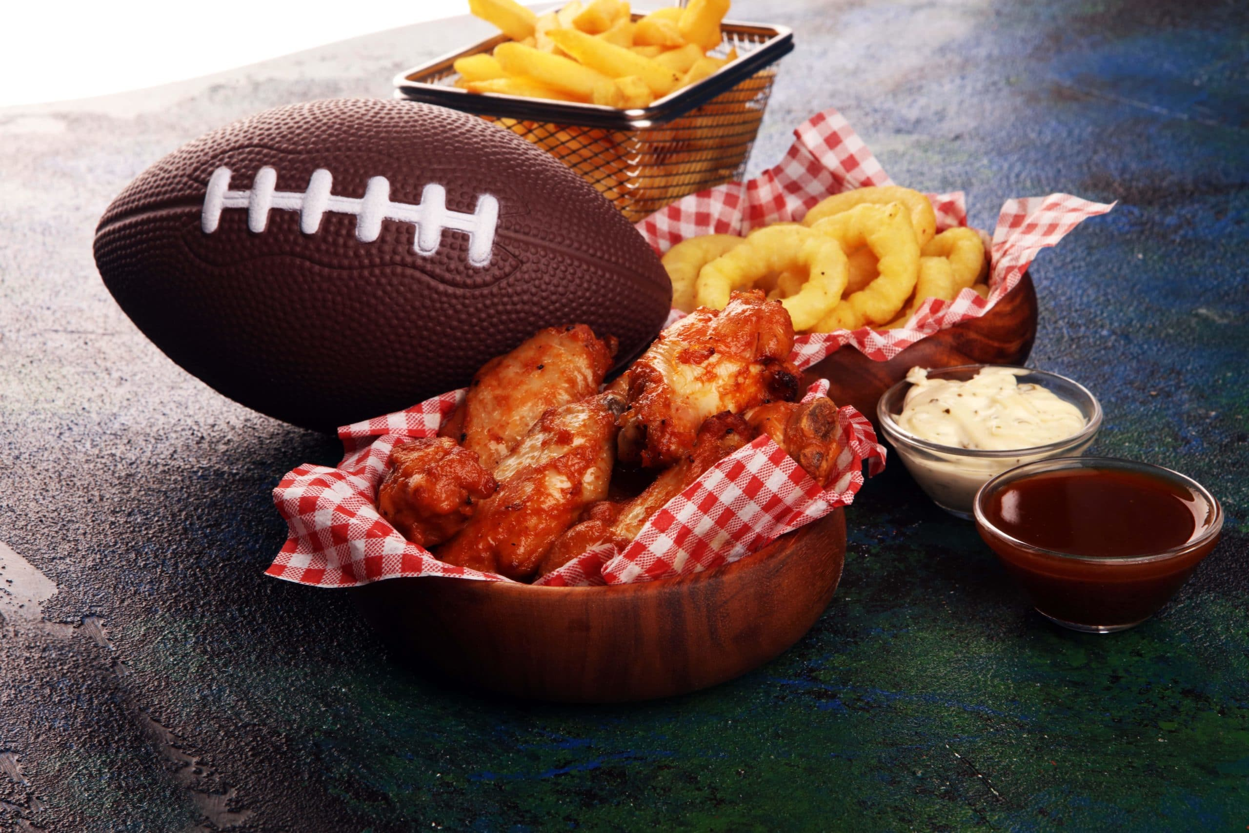 wings and pizza fast food with a football